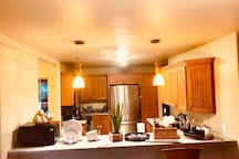 Kitchen is restricted use, however the breakfast bar is available and has amenities such as snacks, microwave, utensils and plates for use. You may also use the sink to wash dishes or use water.