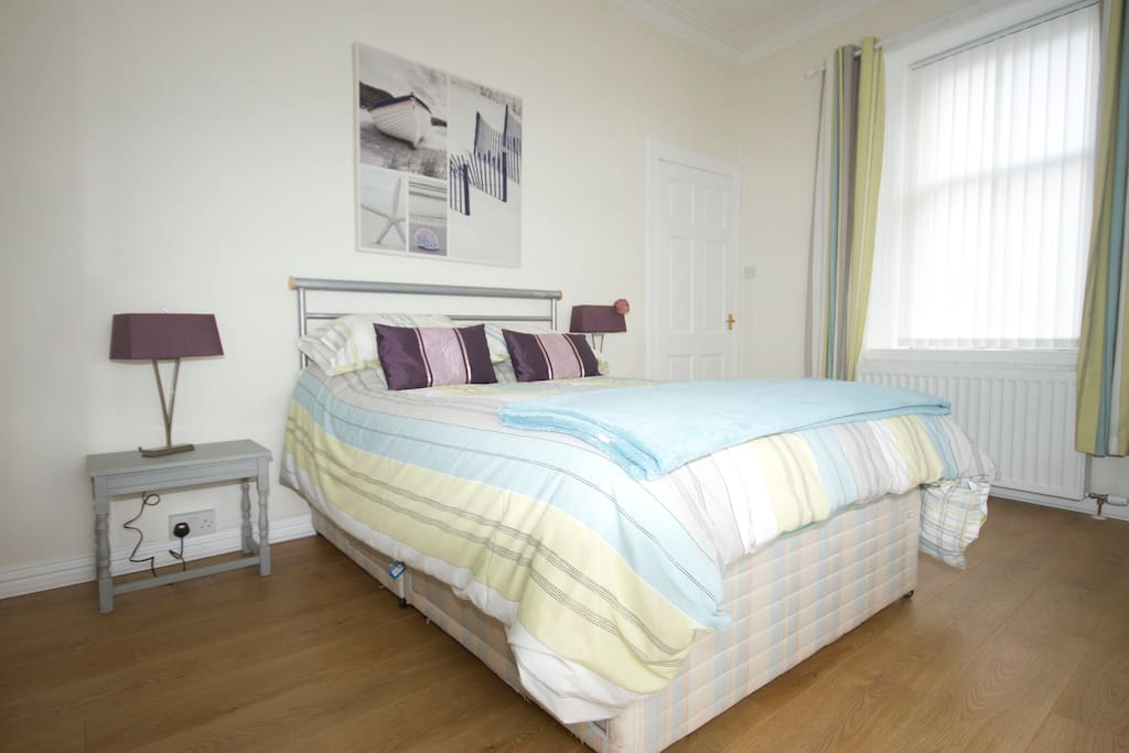 The large double bedroom is tastefully decorated and had plenty storage