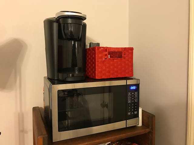 A microwave and Keurig station.