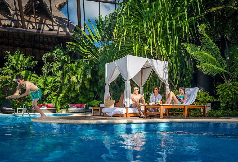 Enjoy the beach chairs and cabanas poolside. Order drinks and food delivered to your chair.