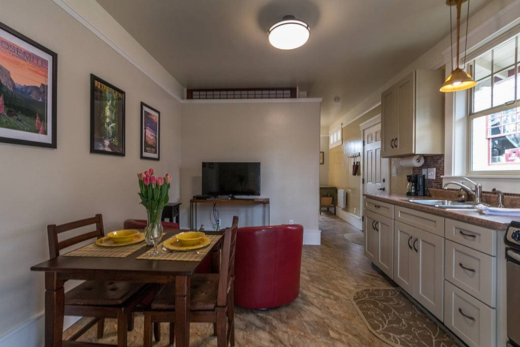 The kitchen is the place to dine and lounge in this 1 bedroom bungalow suite.