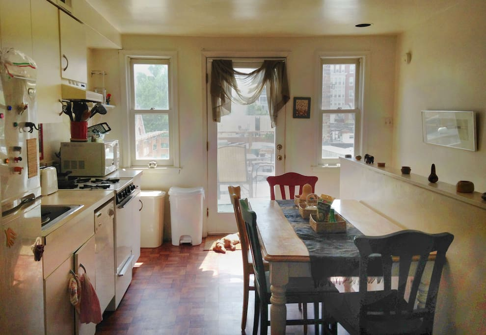Kitchen, adjacent to the living room with access to the deck. Washing machine, microwave, and stove. 2nd floor.