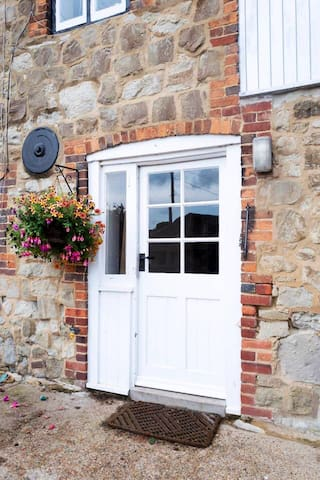 Front door to Oast House. Grade Two listed Kentish Ragstone building.