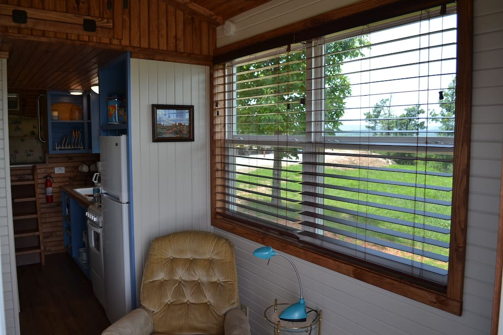 Comfortable, relaxing area to enjoy the outside views from inside the Tiny house. You can also enjoy some quiet reading or sit and watch a movie on the flat screen tv/DVD  available for your entertainment.