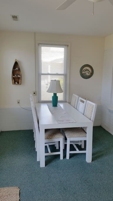 Dining table in sunroom.