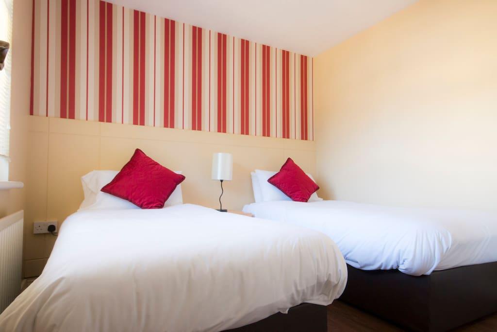 2 single beds in bedroom 2