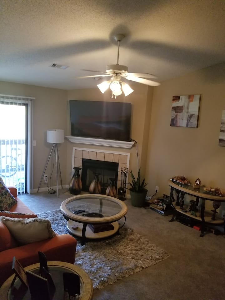 "The living Room area that has a patio accessibility,  Fireplace, 65"" curved television"