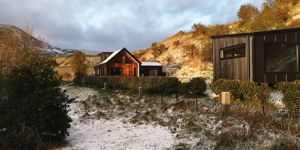 House +separate sleepout in rural setting