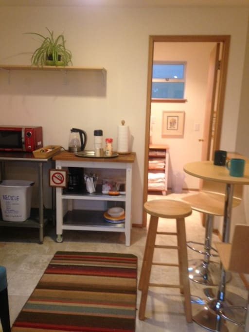Convenient breakfast bar with fridge and microwave.