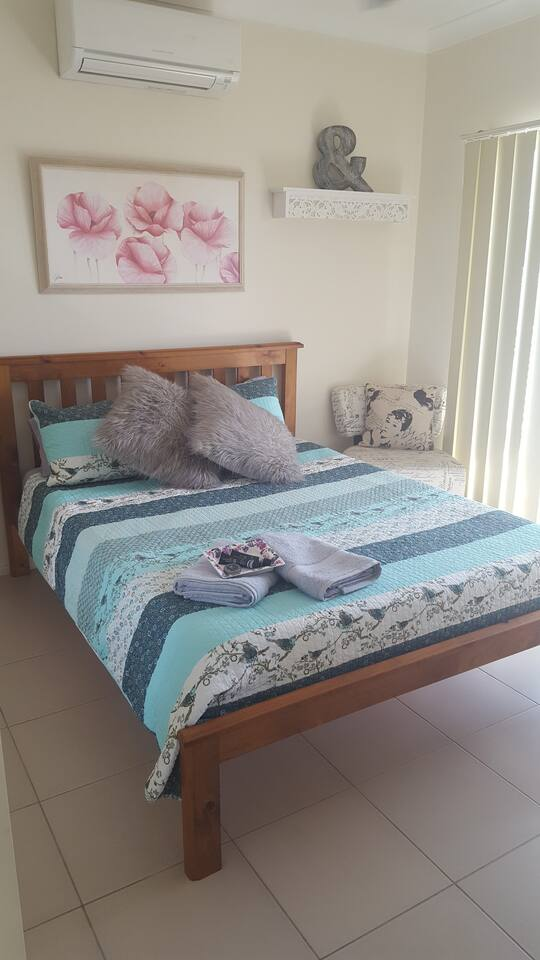 Beautiful Queen sized bed.... fully aiconditioned or leave the sliding door open for the natural breeze.