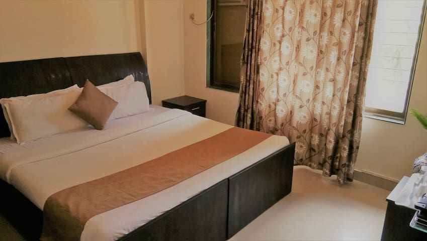 Bedroom with Double bed, wifi enable,  tea coffee maker and television