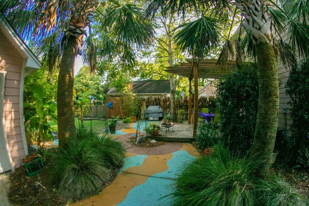 View of backyard gardens from driveway.