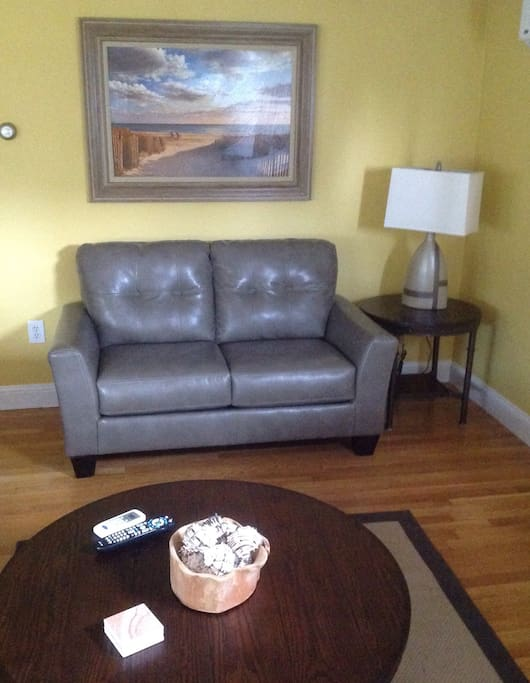 Living room. Gray leather love seat