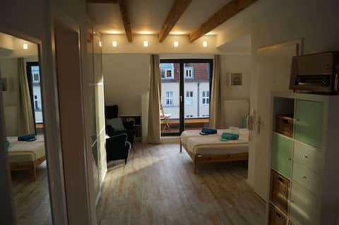 Attic flat, centrally located in calm environment