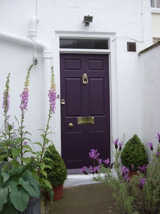 Back door entered through a courtyard  filled with lavender and foxgloves.