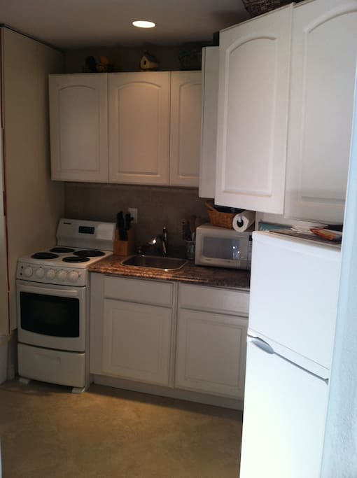 Kitchenette w/ Stove, Micro, Fridge and Cookware