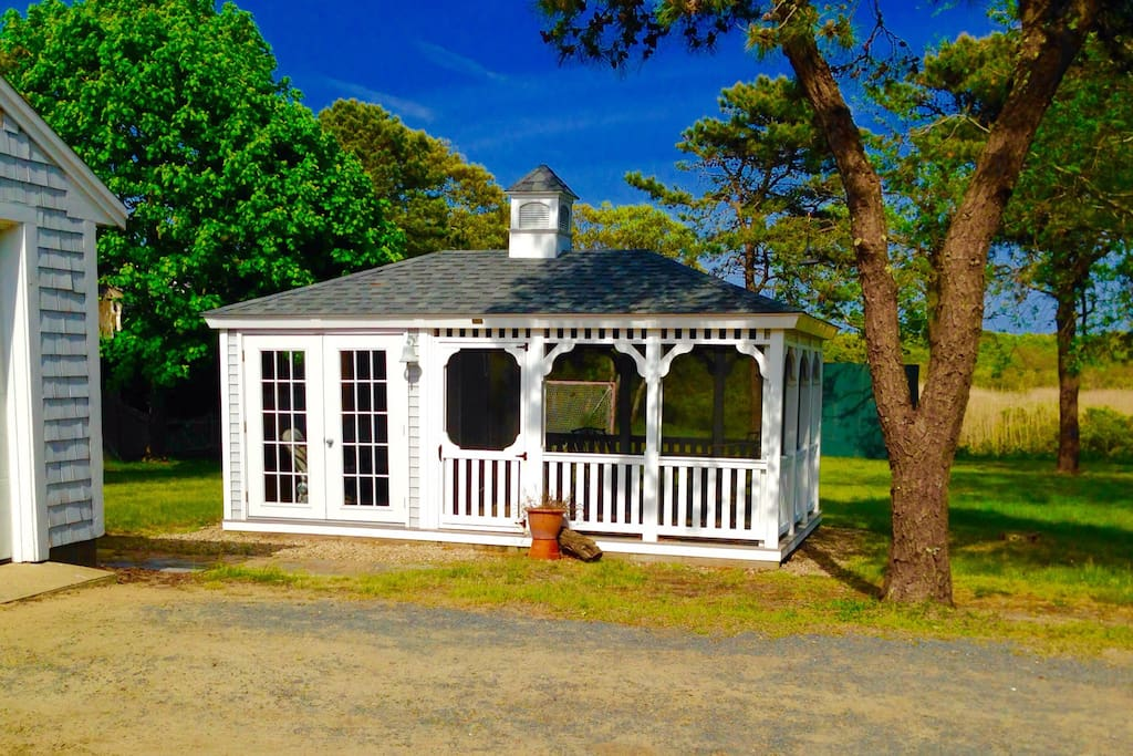 Screened in Gazebo with electricity, lights and lots of seating, big table for eating.  Yard also includes a huge picnic table that seats 10.