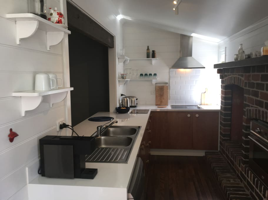 Well equipped kitchen with Ilve appliances: large oven, induction cooktop, and quiet rangehood. Dishwasher. Wood burning stove for cooler nights.