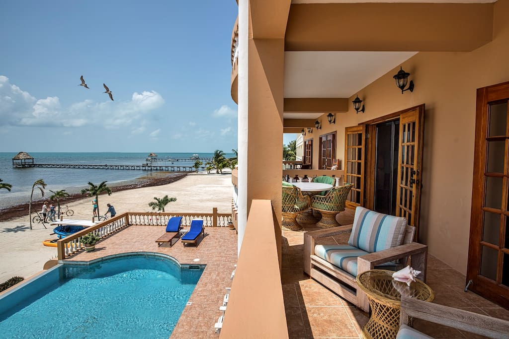 Ultimate indoor/outdoor living! French doors leading to the oceanfront balcony from both the master bedroom & living room!