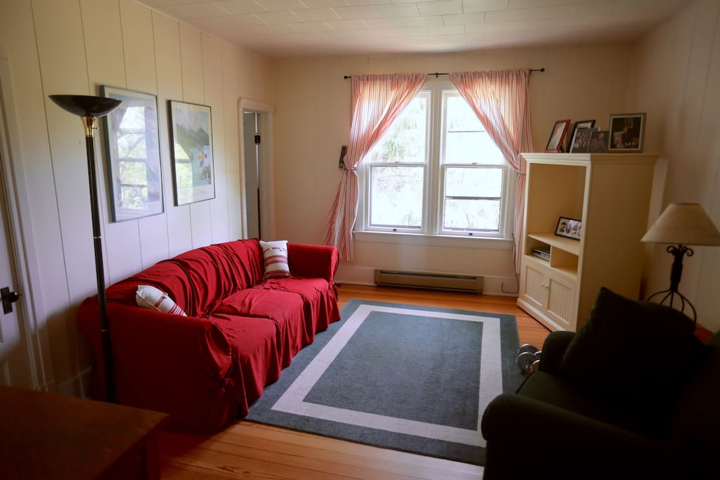 Both bedrooms are accessible from this family room. Guest bathroom is to left of windows.