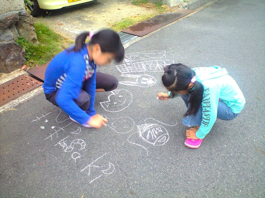 Car street is small , it can also be painting in the road in front of the house.