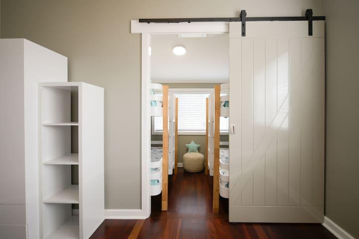 Adjoining Bunk Room. Adjoins Queen Bedroom. Access is through Queen Bedroom.