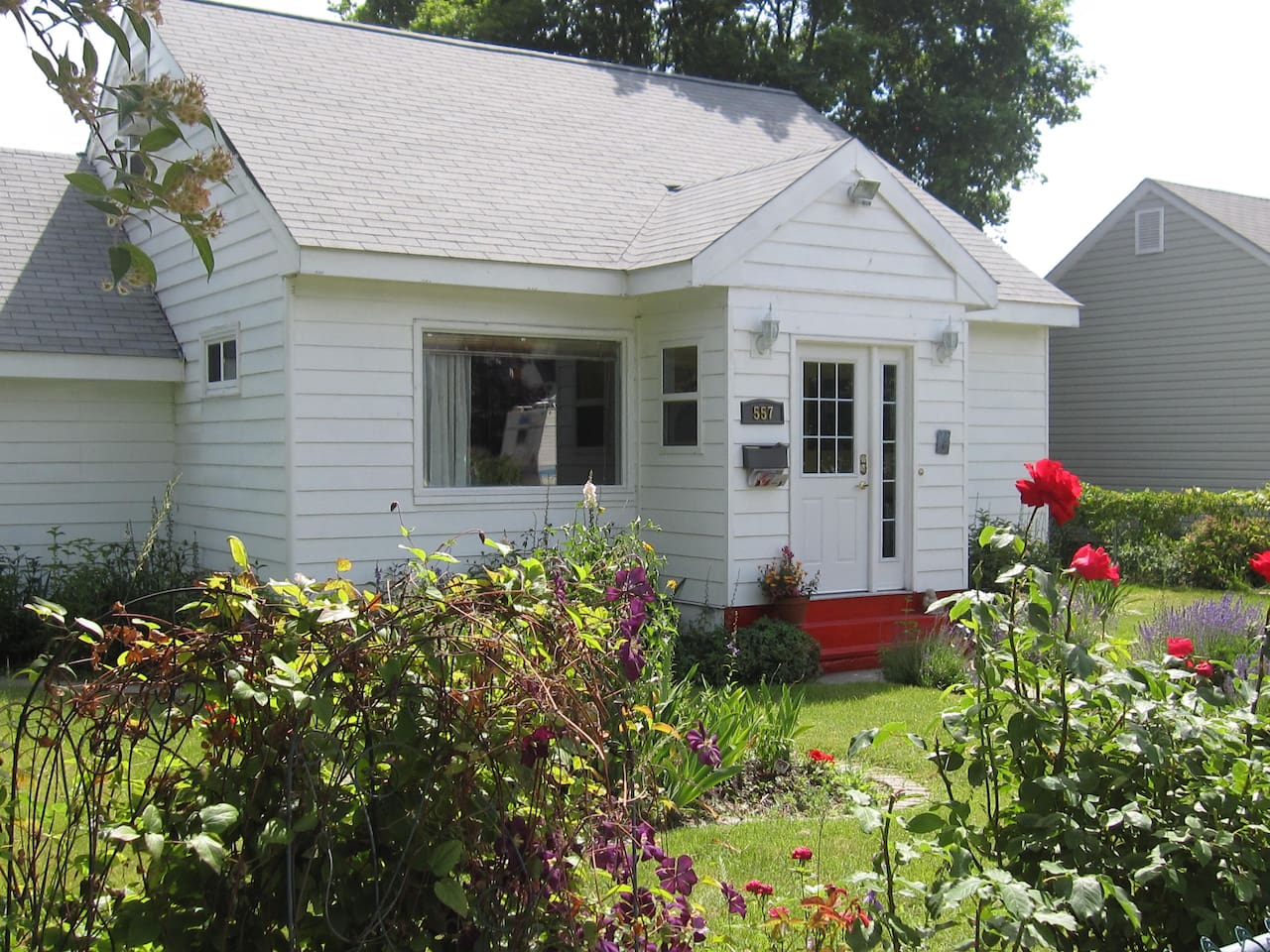This 1946 bungalow was built for returning veterans. Many flowers are heritage blooms.