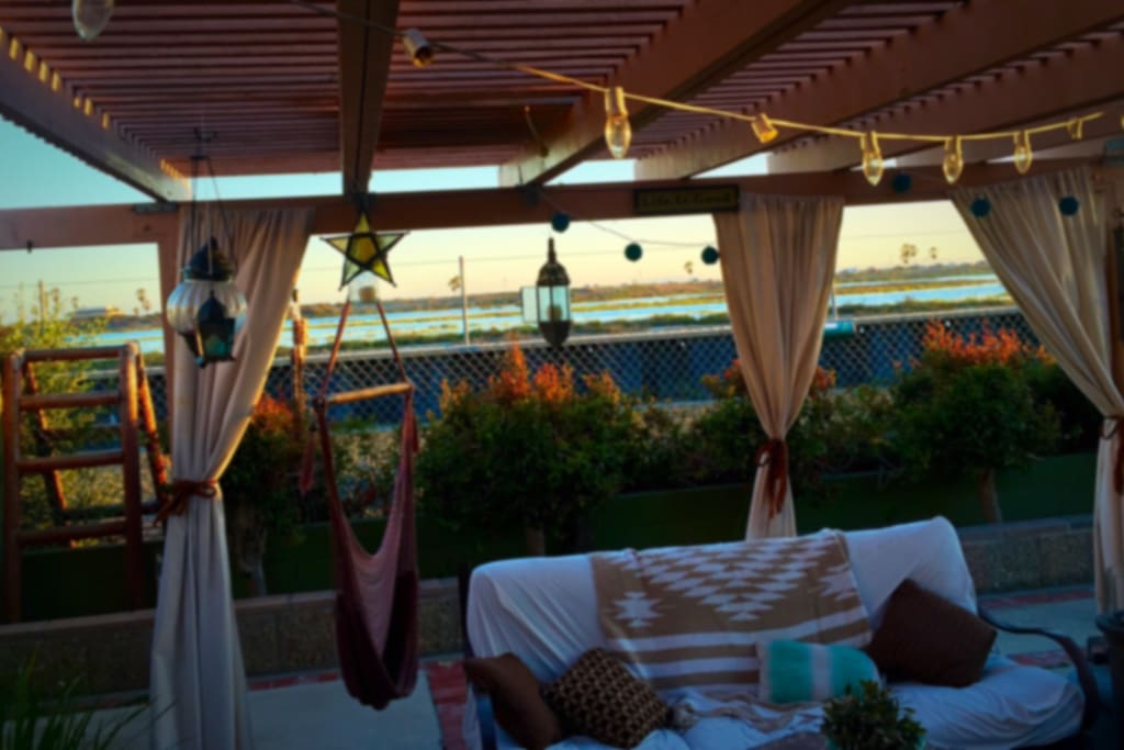 Private covered patio overlooking wetlands and beach. The Sunset views of Catalina are amazing. Go to Sleep w/ the sound of crashing waves every night.