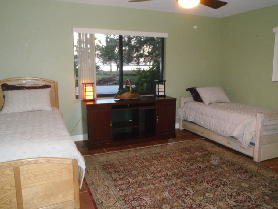 Large bedroom with twin beds with trundle.