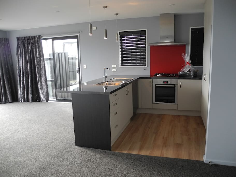 Open plan kitchen and dining area.  Taken before furniture placed.