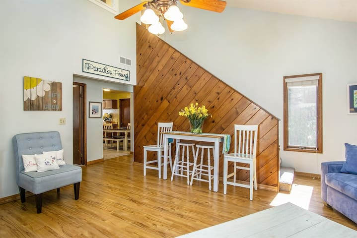 Bright and welcoming living room with soaring ceilings.