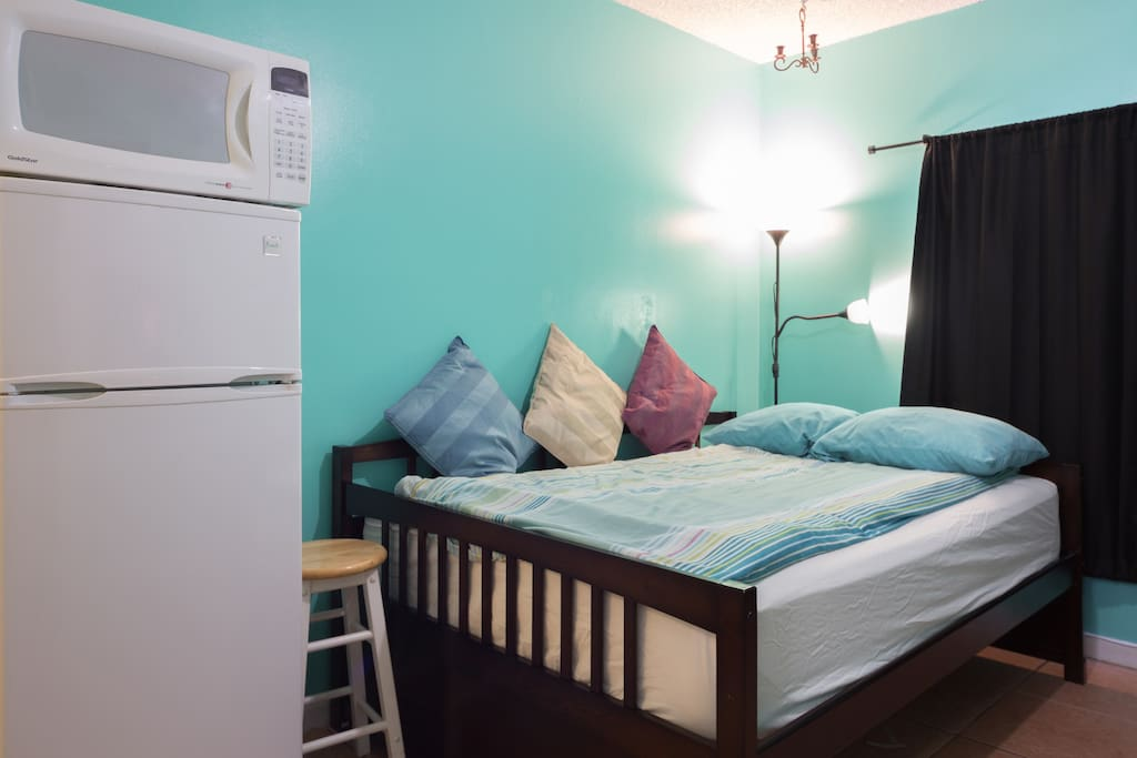 sleeping area is separated from kitchenette by a medium size fridge and a Microwave oven