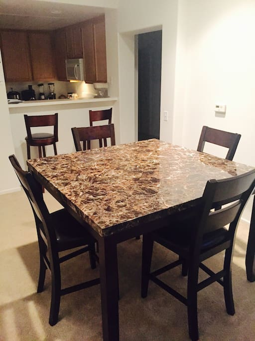 4chairs Dinning room table and 2 bar stools...