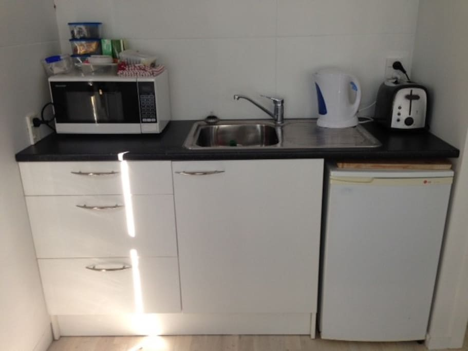 Compact kitchen but with all utensils required and crockery. Rings for cooking if need be. Fridge only, no freezer. Tea and coffee and sugar supplied.