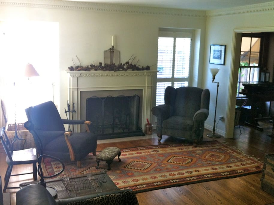 Cozy living room with wood-burning fireplace