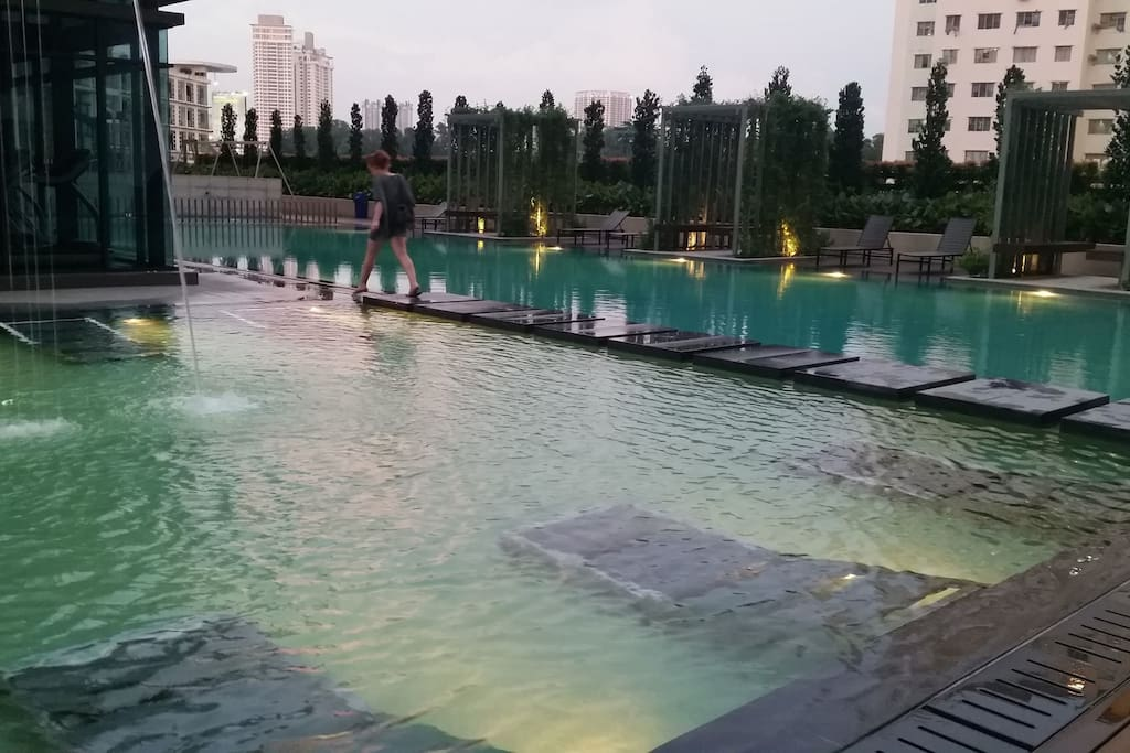 Evening shot - Swimming pool and gym which is free to use - only for residents and guests of the condominium.