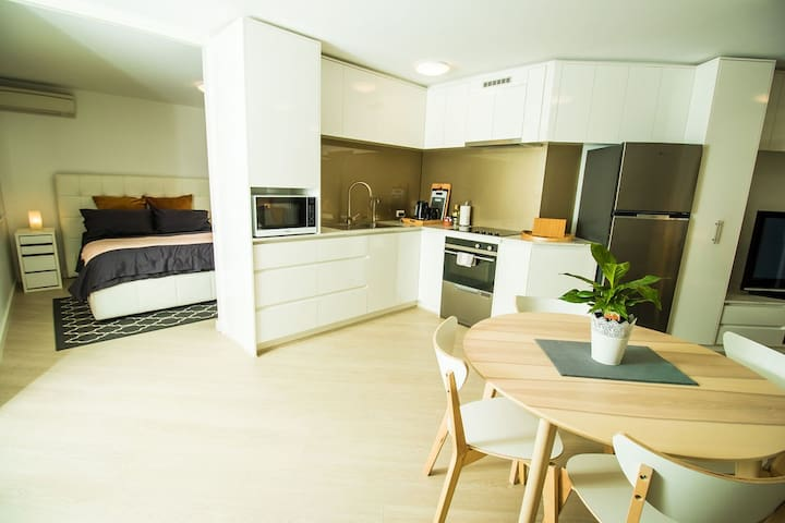 Modern kitchen. A sliding door separates the bedroom from the living area
