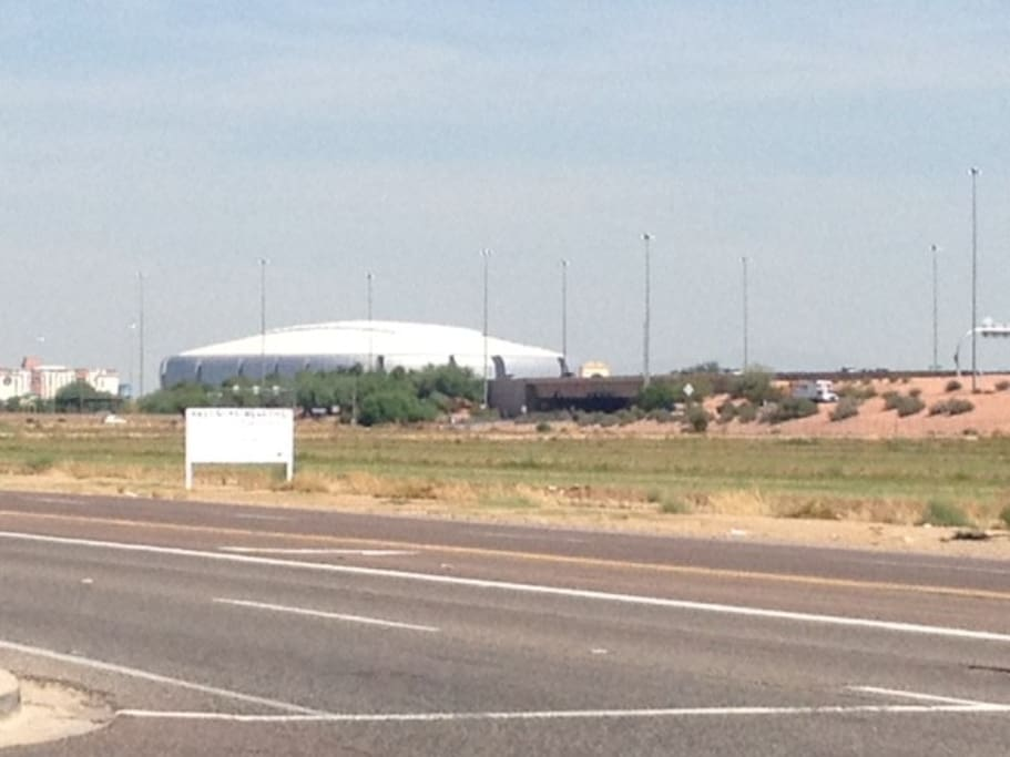 University of Phoenix Stadium, home of the Cardinals football team.  Glendale Arena (Coyotes Hockey) to the left.