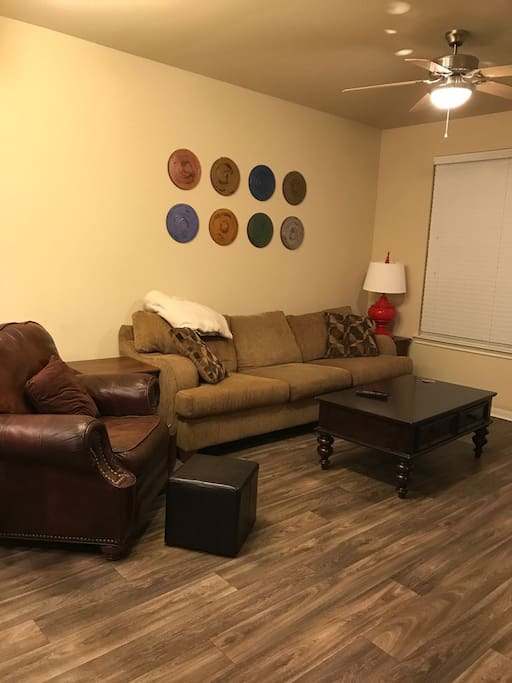 Large comfy couch and leather recliner in spacious living room!