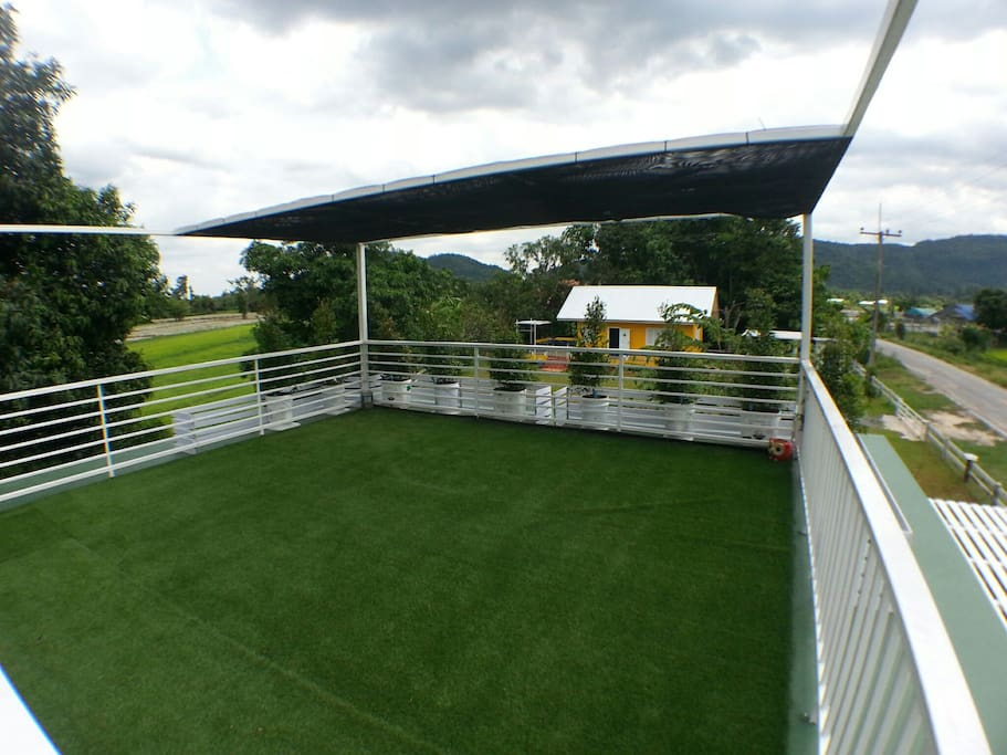 Roof top with artificial grass.  Can put up a tent.