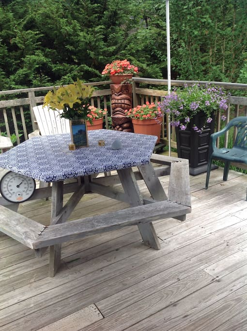 Flowering planters and outdoor seating.