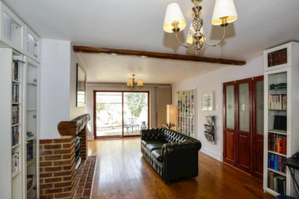 Spacious Lounge. Sliding windows onto sunny but private patio with grape vines.