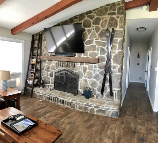 Rustic charm abounds with the flagstone wall in the Main Living Area