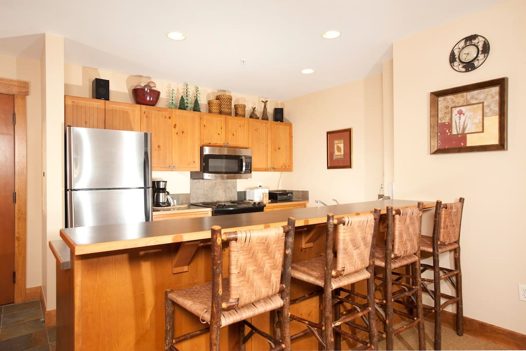Enjoy cooking in the fully-equipped kitchen, complete with stainless steel appliances and convenient breakfast bar