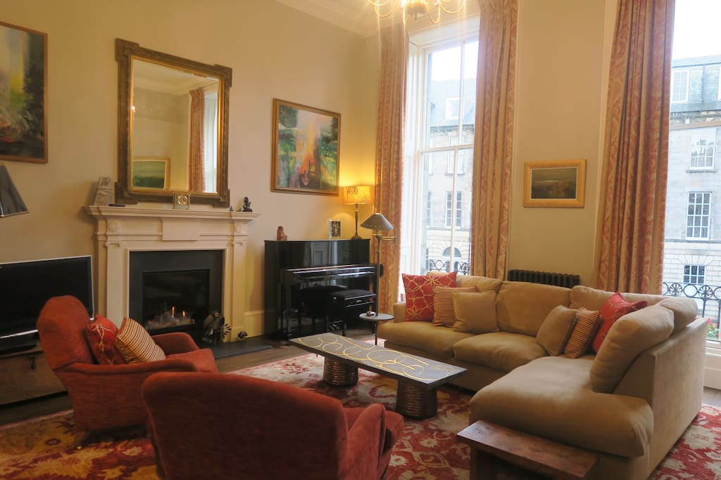 This is a view of our spacious drawing room with its welcoming fire.