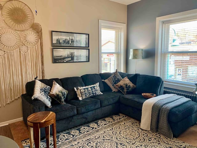 Sunny and cozy loving room with new sectional sofa that sleeps two.