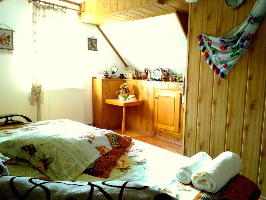 Comfy and snug room with double bed, enriched with traditional ornaments and rugs.