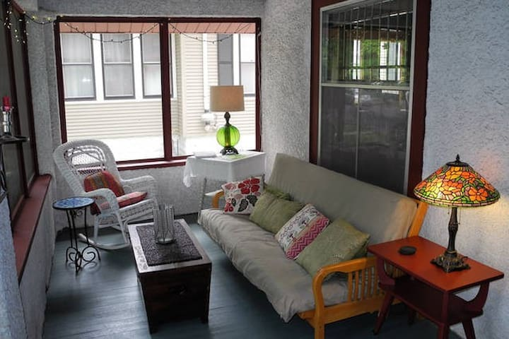 The screened front porch is a highlight for three seasons.
