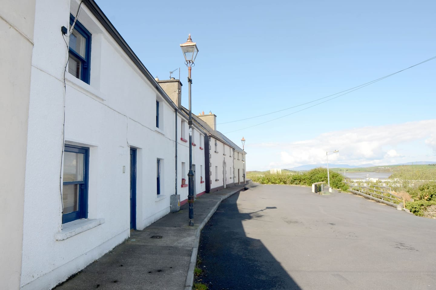 Property (left) with a sea view of Clew Bay