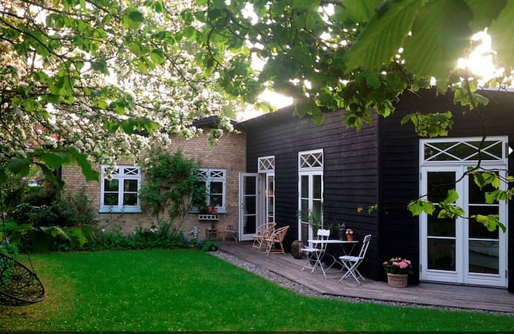 Bright and cosy family home with private garden.